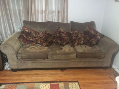 Couch Loveseat. area rug and matching throw pillows