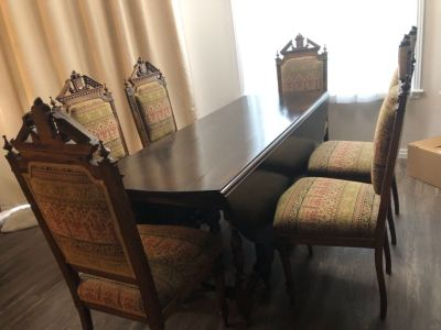 Large 18 century Antique walnut dining table with  Leaf and 6 chairs. Bought for $7000 25 years ago