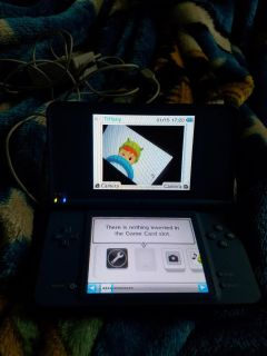 Nintendo DSi XL with charger and 6 games