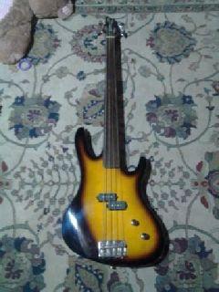 Rare fretless washburn bass guitar& Carlo Robellie guitar