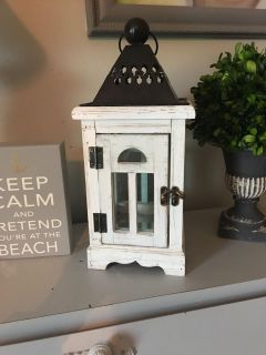 ADORABLE WOODEN LANTERN (top is metal ) it measures 14 inches tall