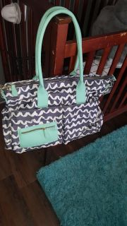 Diaper bag with multiple pockets.