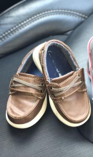 Boy sperry shoes.