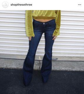 Dark wash flare jeans purchased from These Three Boutique