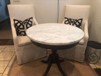 Antique table with Carrara marble top.