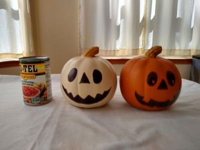 Two small forever painted pumpkins