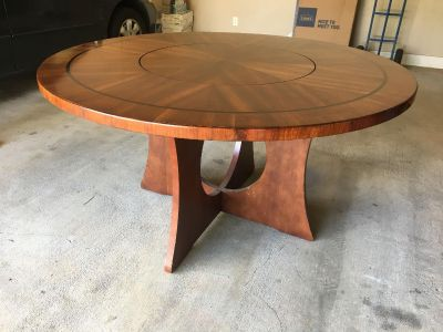 56 round dining table with lazy-susan center; great condition, beautiful solid wood