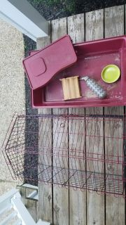 Guinea pig cage. Well used, but still does the job. Comes with hay holder, water bottle and food dish