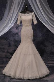 Lynette's Applique Lace Mermaid Wedding Gown