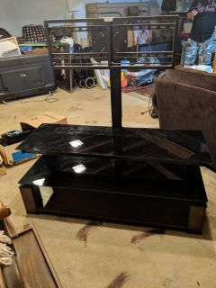 """Mountable tv stand. Holds up to 55"""" tv."""