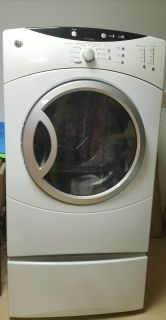 GE Front load washer and dryer set with pedestals