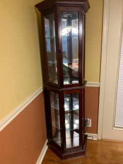 Cherry Haverty s curio cabinet with light