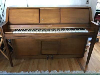 Player Piano with over 100 rolls