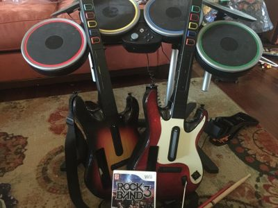2 guitars, drums, and rock band game