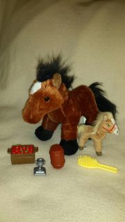Horse with a little one, apples, barrel, and a brush . A trophy also.