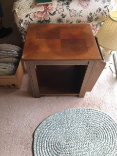 end table with writing and magazine storage