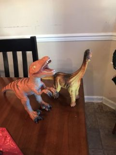 2 large rubber dinosaurs