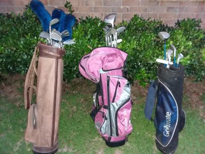 Adult left, jr and child right hand golf clubs with bags
