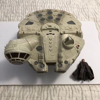 Star Wars Millennium Falcon And Action Figure.