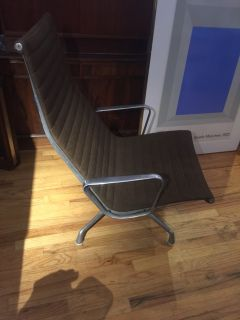 Eames aluminum group lounge chair.