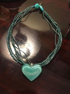 Gorgeous glass heart beaded necklace! Turquoise/sea blue color. It s just been sitting in my jewelry box.