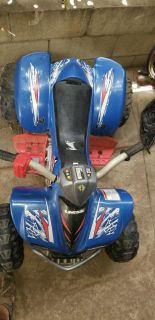 Kids Kawasaki Quad with Battery and Charger included