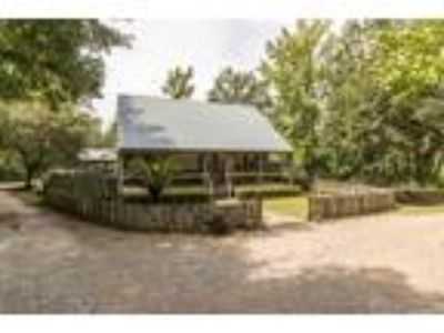 Inn for Sale: Cajun Country Cottages Bed and Breakfast