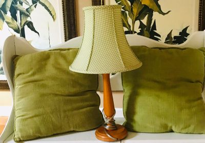 Lamp and 2 green throw pillows