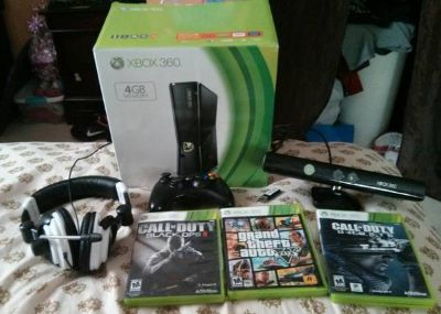 look cheap  Xbox 360 slim with cod . gtv .and kinect and headset