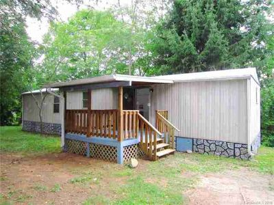 24 Holly Ridge Road Candler, Well Maintained Home On Large
