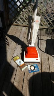 Hoover vacuum cleaner, older model but works great. Comes with extra bags and belt.