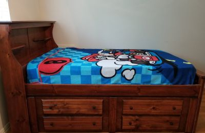 Bed -full size captain's bed set with built in drawers and a desk