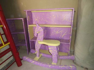 childs rocking horse and bookshelves