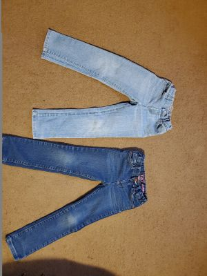 Two girls size 5T jeans. Both great condition.