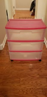 Pink and clear 3 drawer rolling cart. Chipped on the back side.