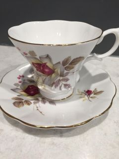 Royal Imperial bone china tea cup and saucer. Has a snow flake inside cup.