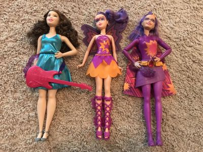 3 Brand New our of pkg Barbies w/accessories