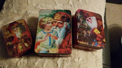 Christmas tins stack inside one another for storage