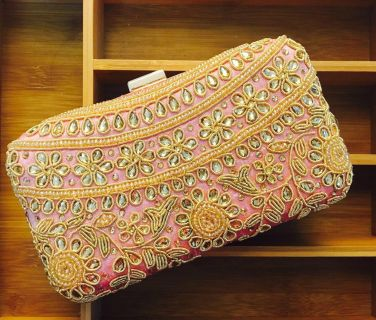 Handmade clutch with sling