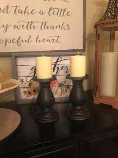 BLK CANDLESTICKS W/ CANDLES . They measure 11 inches tall . Perfect for your table for Christmas!
