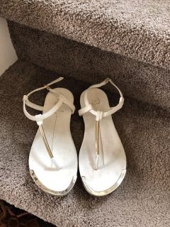 White T-strap sandals with silver accents. Size 3