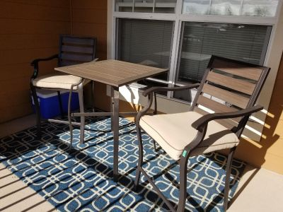 Patio bar height table and 2 chairs
