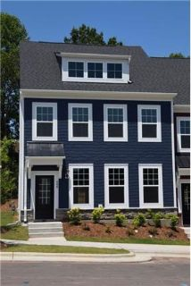 This large, brand new executive townhome is bright and open!