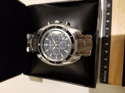 Man watch $12 new with box. Unused.