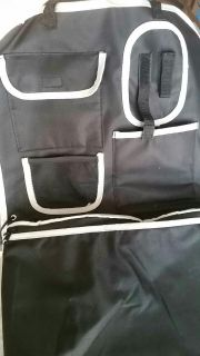 Car organizer fits on back of seat. Clips around headrest.