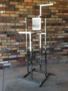ADJUSTABLE CLOTHING RACK WITH SIGN HOLDER