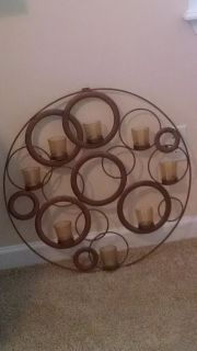 Circular candle sconce