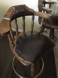 Vintage antique leather bar stools with padding