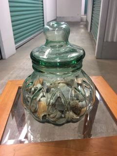 Large jar with lid and shells