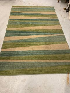 5 x 8. Blue, Green, and Tan Area Rug